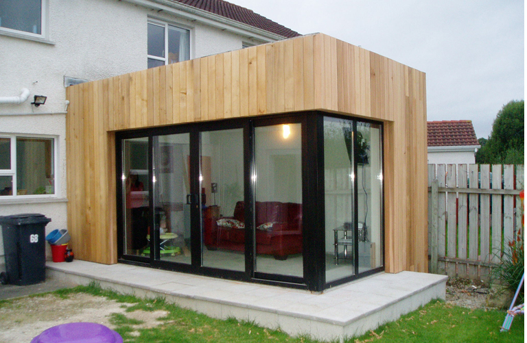 Modern elmwood extension architects ballymena antrim for Cedar sunroom