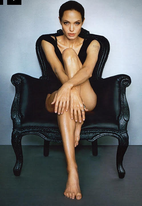 Look, here is a scantily clad Angelina sitting on a carbonised chair by Maarten Baas for Moooi.