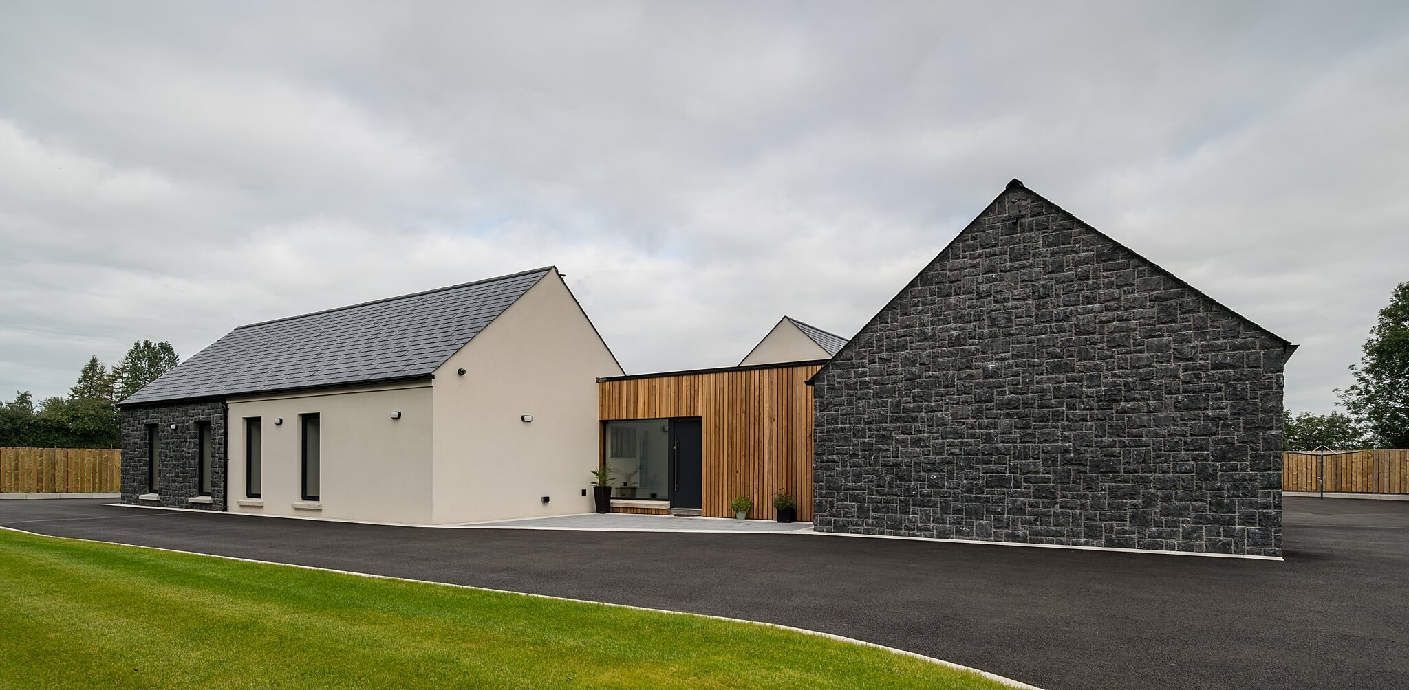 modern house frontage with timber cladding and stone walls