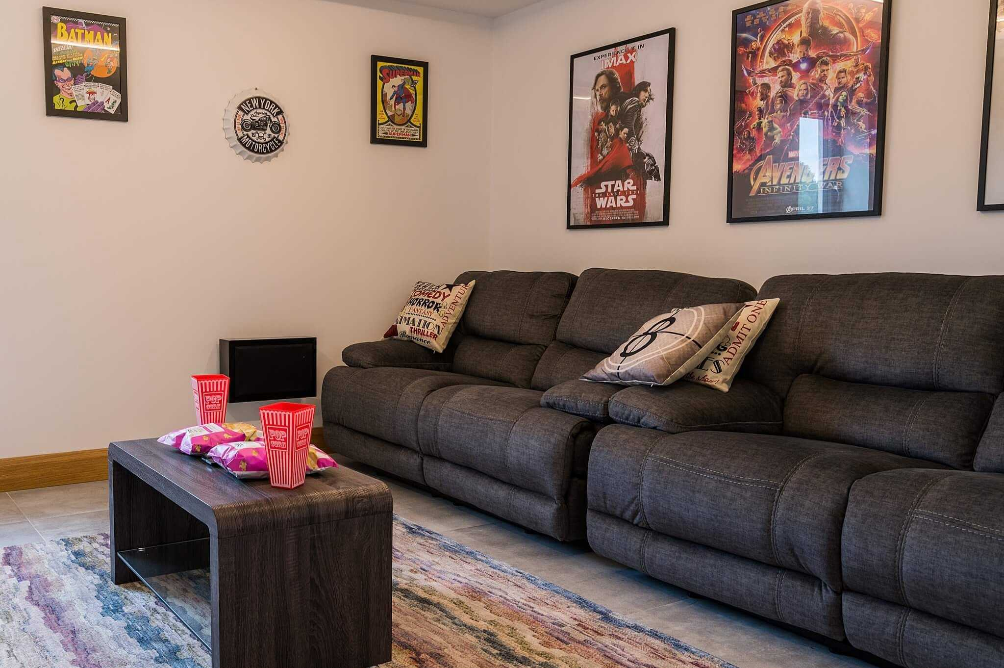 home cinema room with sofas and film posters