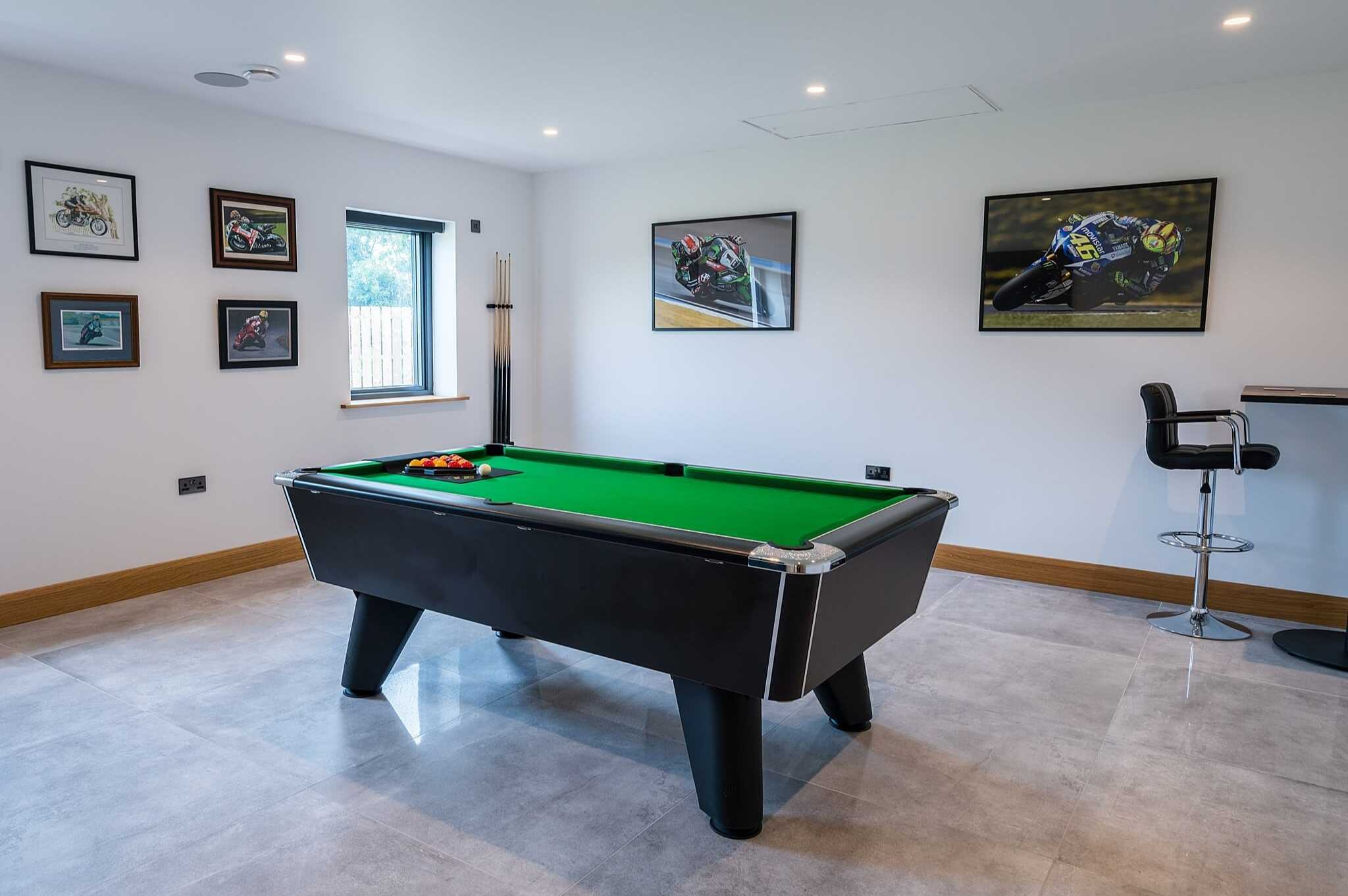 racing posters in pool room the house man cave