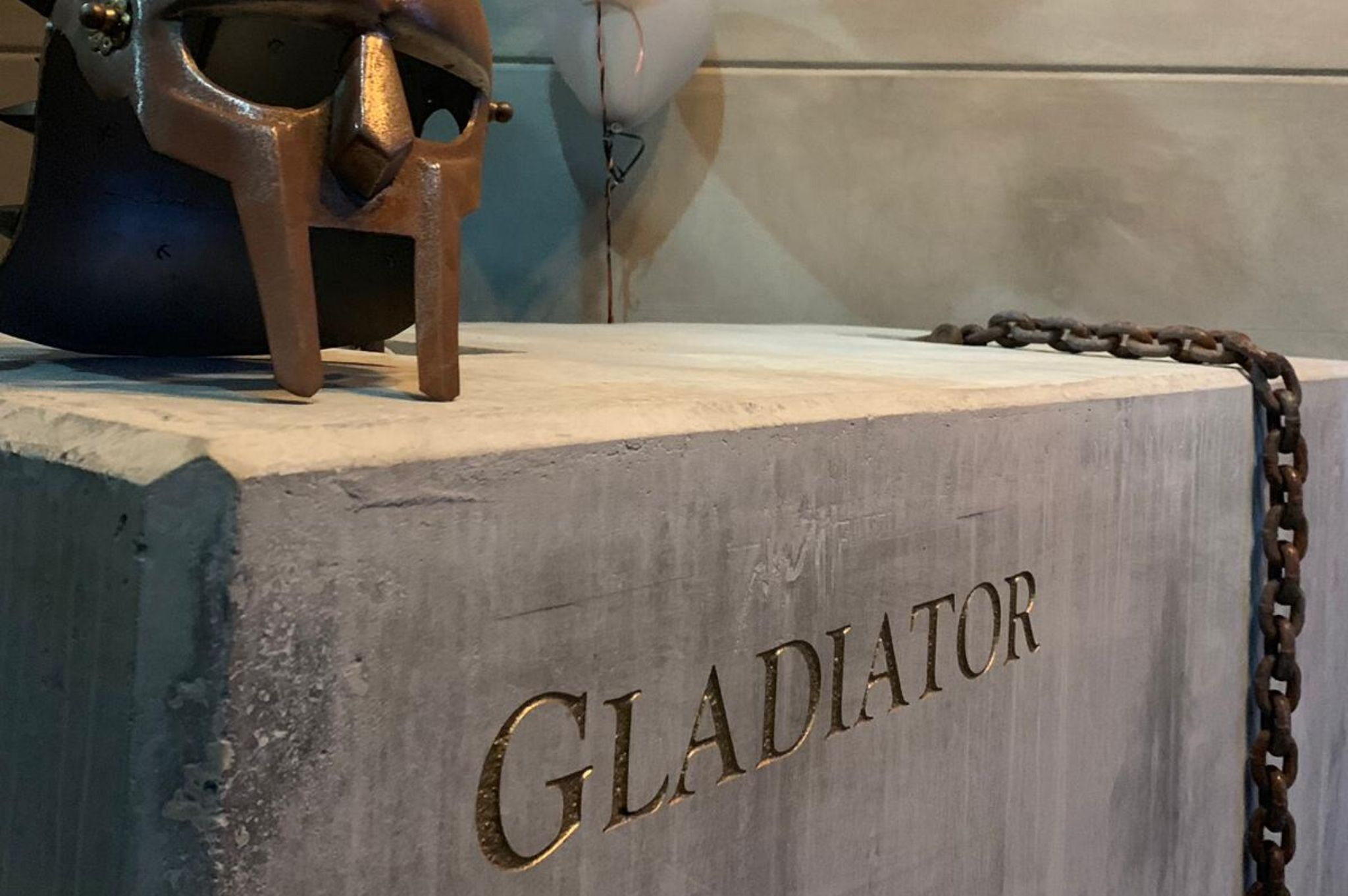concrete block at entrance to gladiator gym