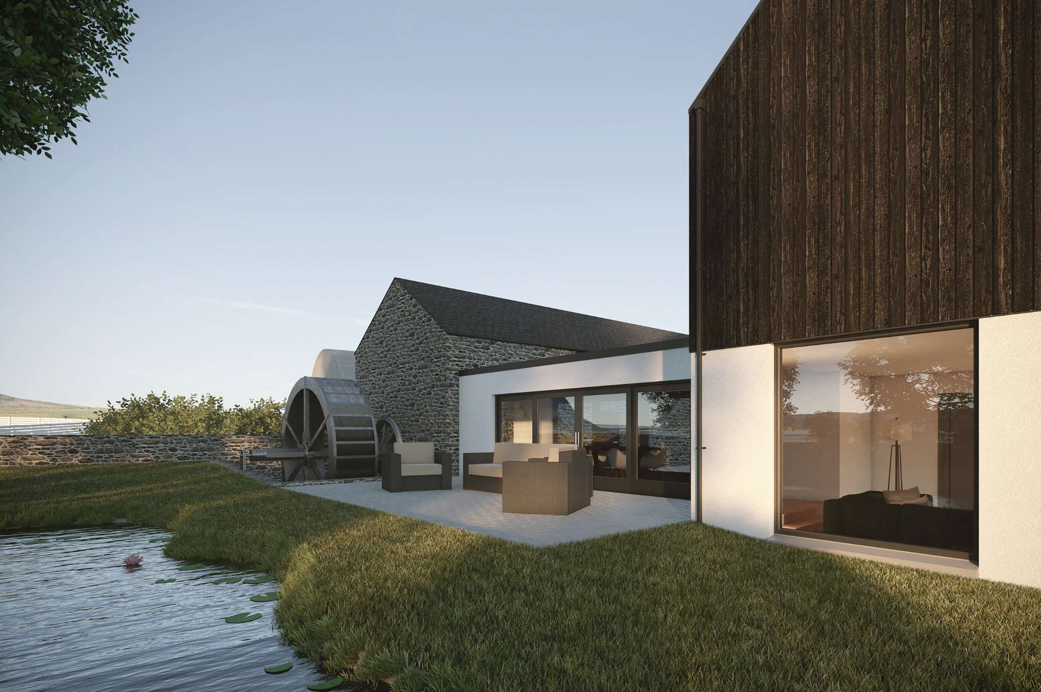 modern house with barn water wheel and pond